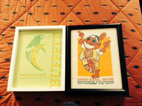 Grateful Dead and Jimmy Buffett tee shirts framed and displayed in a Shart T Shirt Frame Display Case