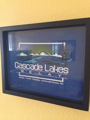 Cascade Lakes Relay tee shirt framed and displayed in a Shart T Shirt Frame Display Case