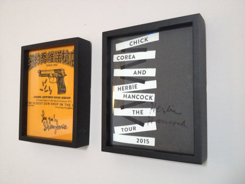 Sharon Jones and Herbie Hancock signed tee shirts framed and displayed in a Shart T Shirt Frame Display Case