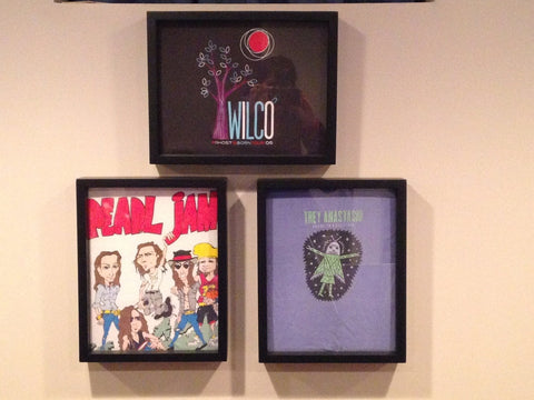 Pearl Jam, Wilco and Trey Anastasio tee shirts framed and displayed in a Shart T Shirt Frame Display Case