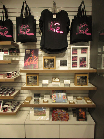 Retail Display of tee shirts framed and displayed in a Shart T Shirt Frame Display Case