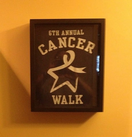 Cancer Walk tee shirt framed and displayed in a Shart T Shirt Frame Display Case