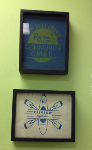 Rainbow co-op tee shirts framed and displayed in a Shart T Shirt Frame Display Case