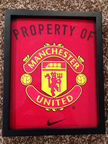 Manchester United tee shirt framed and displayed in a Shart T Shirt Frame Display Case