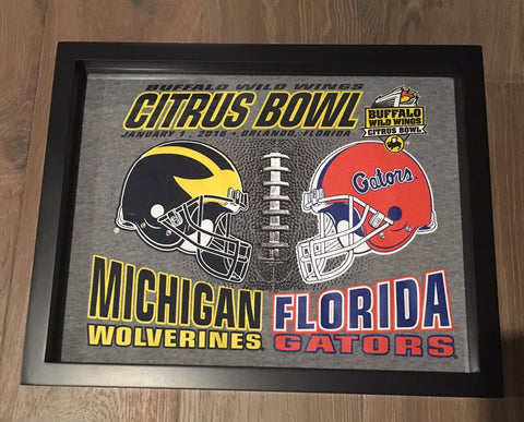 Citrus Bowl Michigan Wolverines and Florida Gators tee shirt framed and displayed in a Shart T-Shirt Frame Display Case