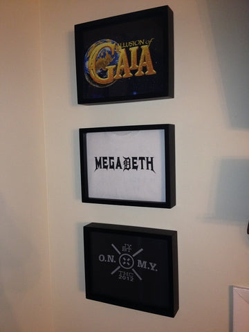 Megadeth and Heavy Metal tee shirts framed and displayed in a Shart T Shirt Frame Display Case