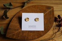 sourire brass accessory  pierced earrings / recit (story)