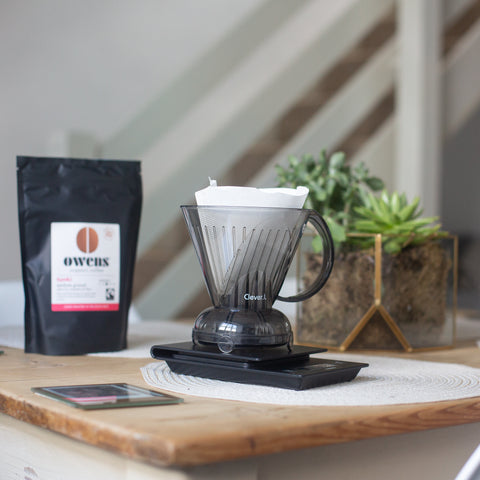 Clever Dripper coffee maker on countertop with bag of Owens Coffee