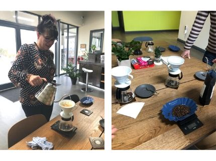 Woman taking part in a barista coffee experience with coffee making equipment on table