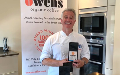 Peter Gorton Master Chef of Great Britain holding Owens Coffee