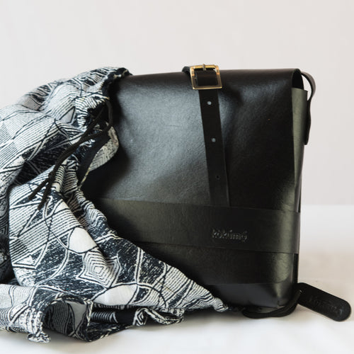 Black leather saddle bag and dust bag