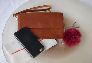 brown jollof leather clutch in bowl