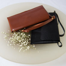 Black and brown jollof leather clutch in bowl