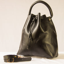 Black Dodo bucket bag with handle and adjustable strap