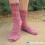 Azalea Socks Pattern - A feminine, top down, knit sock pattern with pretty stitch details including twisted ribbing around the leg, eyelets across the foot and yarn over short row heels and toes