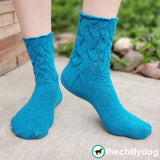 Riptide Socks Knitting Pattern PDF featuring Cobasi by HiKoo® yarn in the 2020 Color of the Year, Kind of a Big Teal: Top down sock pattern for women
