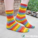 Sundog Socks Knitting Pattern PDF featuring Zitron Trekking XXL Self-Striping Yarn: top down sock pattern for men and women