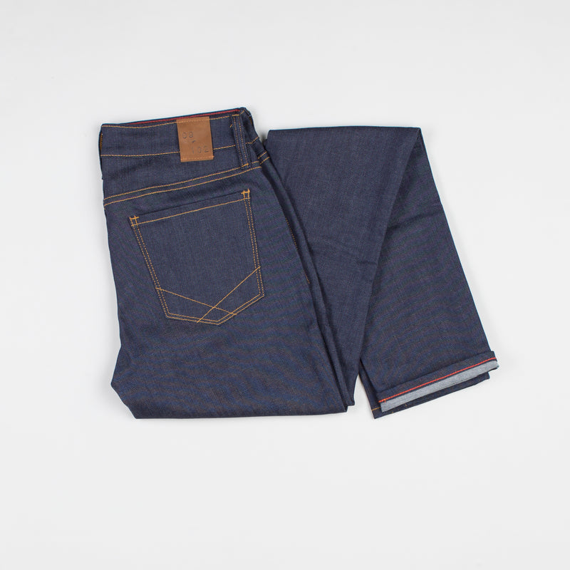 angle: indigo  Raleigh Denim Workshop Surry mid-rise thin raw dark jeans, back view