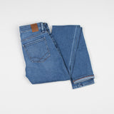 angle: winston  Raleigh Denim Workshop Surry mid-rise thin jeans in a light wash, back view