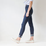 angle hover: phantom  A model wears Raleigh Denim Workshop Haywood high-rise skinny fit dark blue jeans, side view