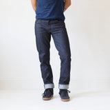angle hover: 319 raw  A model wears Raleigh Denim Workshop Jones thin fit raw jeans in blue, front view