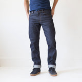 angle hover: 319 raw  A model wears Raleigh Denim Workshop Alexander work fit jeans raw in blue, front view