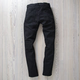 angle: black  Raleigh Denim Workshop Martin thin taper fit stretch pants in black, back
