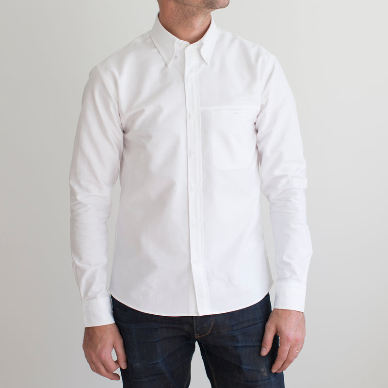 angle: white  A model wears Raleigh Denim Workshop Welt-pocket Button-up in white, front view
