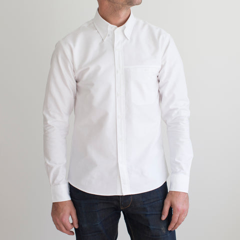 angle: white | A model wears Raleigh Denim Workshop Welt-pocket Button-up in white, front view