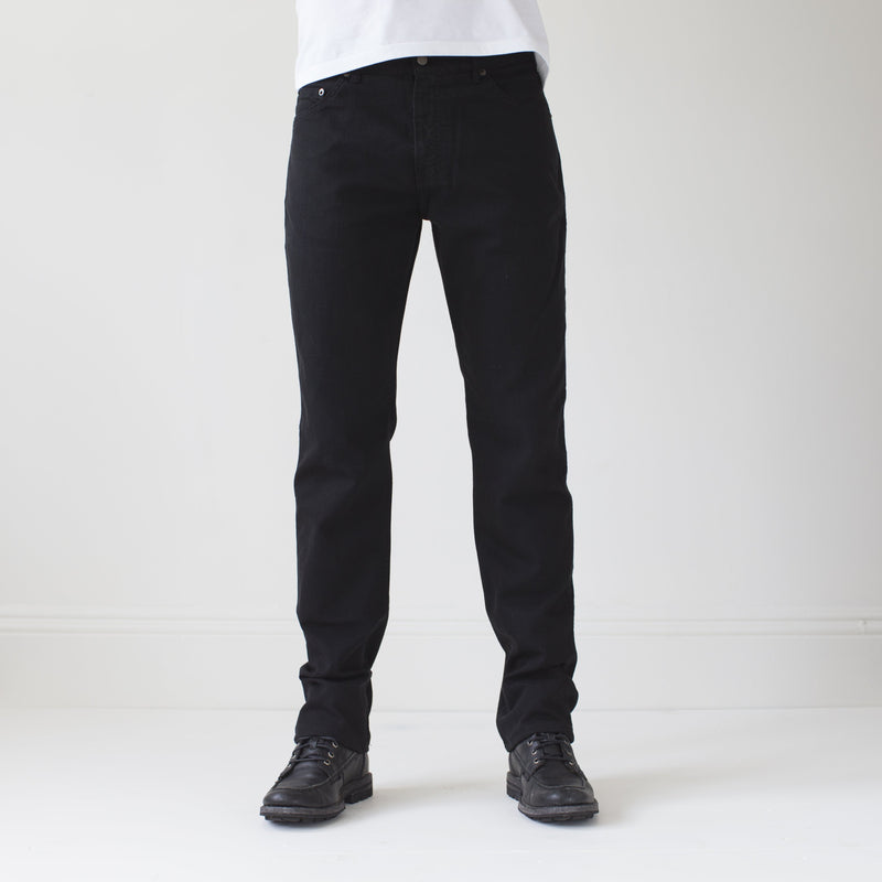 angle hover: black  A model wears Raleigh Denim Workshop Alexander work fit stretch pants in black, front
