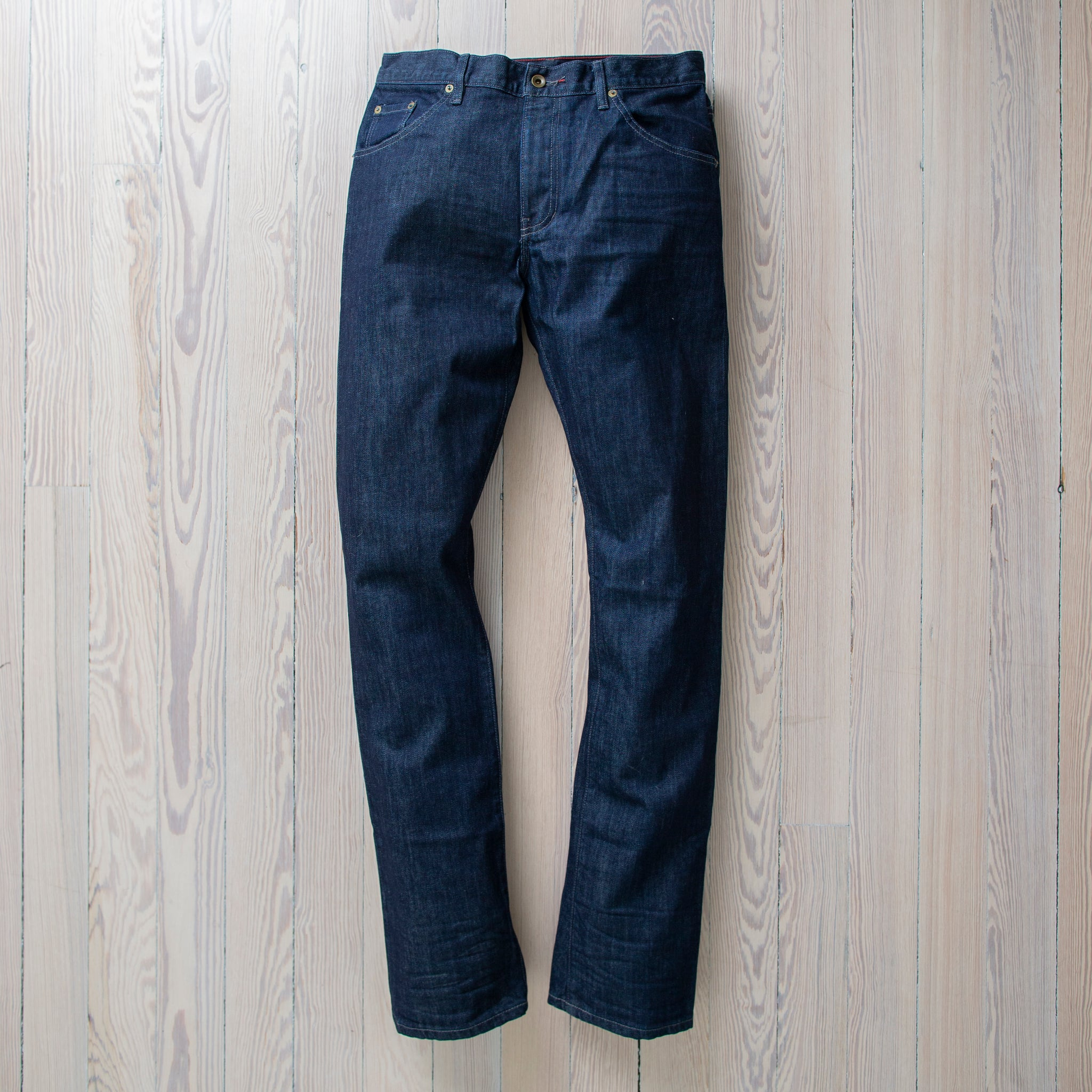 angle: resin rinse  Raleigh Denim Workshop Jones thin fit in a dark wash, front view