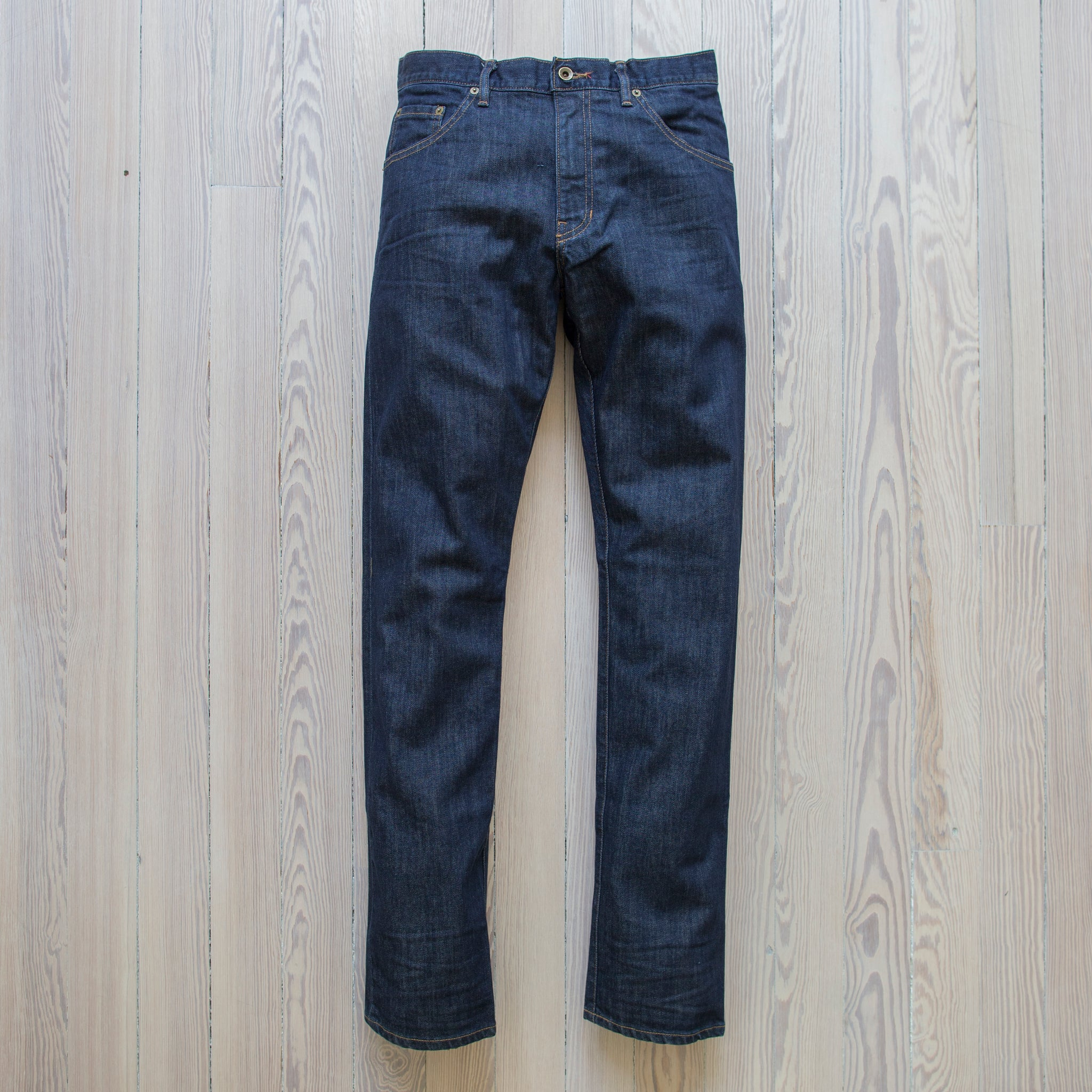 angle: resin rinse  Raleigh Denim Workshop Alexander work fit jeans with a dark wash, front view