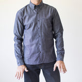 angle: denim  A model wears Raleigh Denim Workshop Welt-Pocket Button-up men's shirt in denim, front
