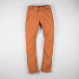 angle: chestnut  Raleigh Denim Workshop Jones thin fit pants in chestnut orange, front flat view