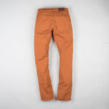 angle: chestnut  Raleigh Denim Workshop Jones thin fit pants in chestnut orange, back flat view