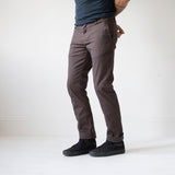 angle hover: smoke  A model wears Raleigh Denim Workshop Jones thin fit pants in smoke, front view