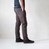angle hover: smoke  A model wears Raleigh Denim Workshop Jones thin fit pants in smoke, side view