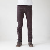 angle: walnut  A model wears Raleigh Denim Workshop Alexander work fit stretch pants in brown walnut, front