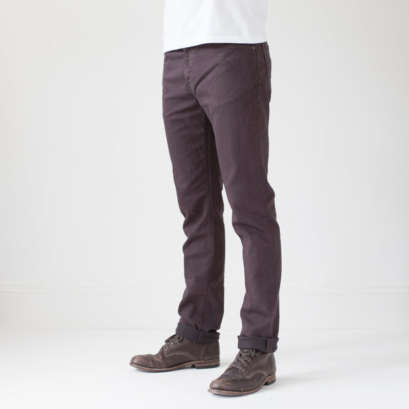 angle hover: walnut  A model wears Raleigh Denim Workshop Alexander work fit stretch pants in brown walnut, front