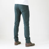 angle: juniper  A model wears Raleigh Denim Workshop Alexander work fit stretch pants in green-blue juniper, back view