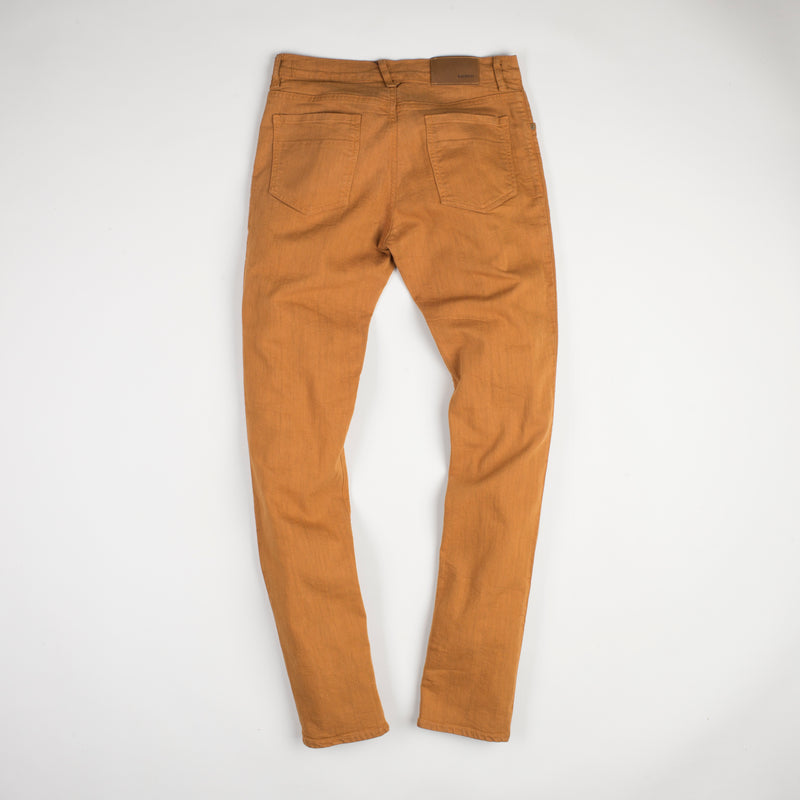 angle: chestnut  Raleigh Denim Workshop Alexander stretch pants in orange chestnut, front back view.