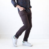 angle: walnut  Raleigh Denim Workshop Martin thin taper fit stretch pants in brown walnut, side view
