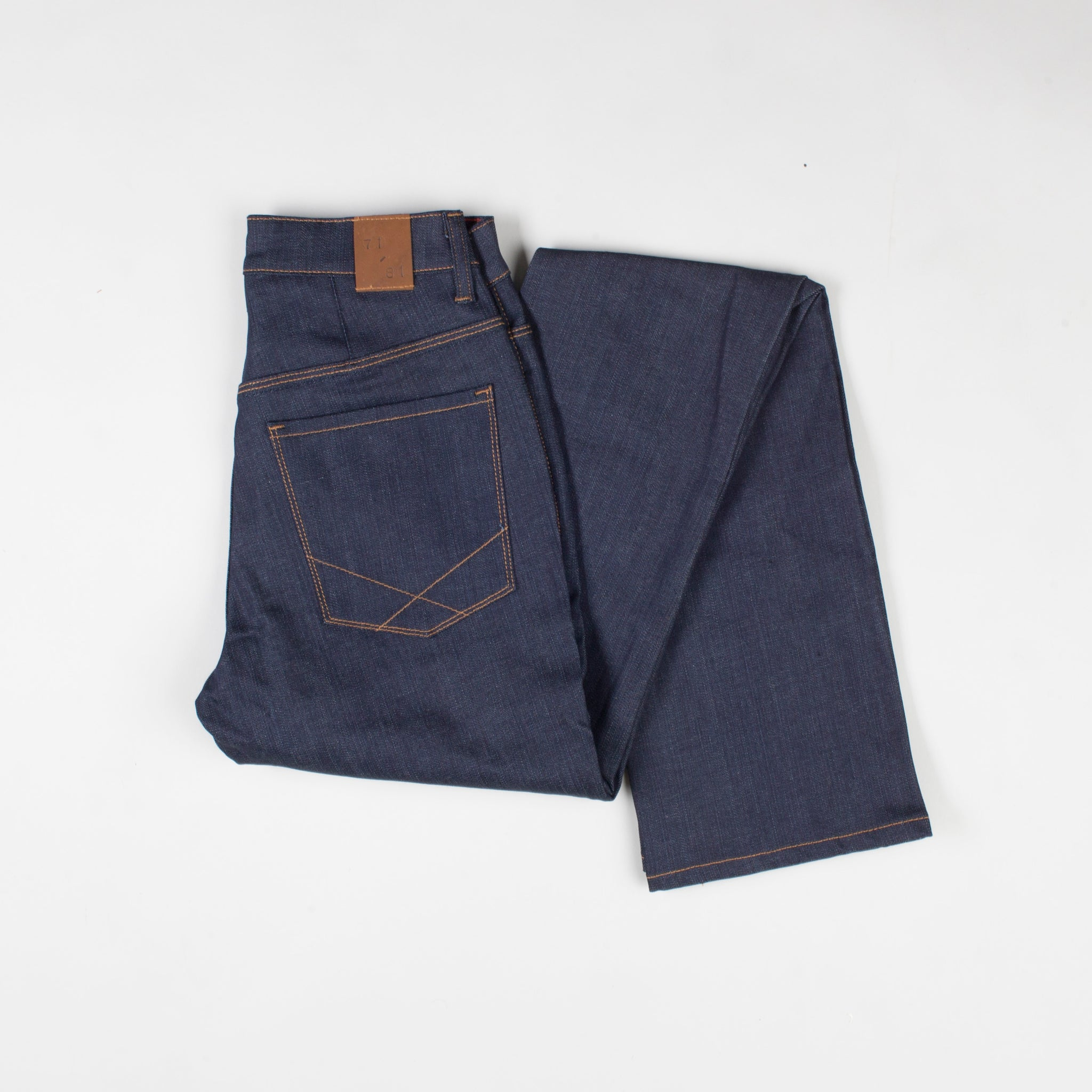 angle: indigo  Raleigh Denim Workshop Madison high-rise straight leg raw dark jeans, flat
