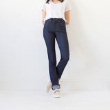 angle: indigo  A model wears Raleigh Denim Workshop Madison high-rise straight leg raw dark jeans, front view
