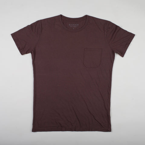 angle: walnut | A model wears Raleigh Denim Workshop cotton/modal pocket crew neck tee in brown walnut