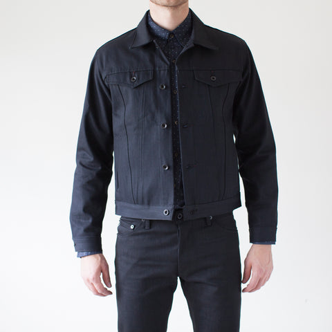 angle: black | A model wears Raleigh Denim Workshop Denim Jacket in black, front view
