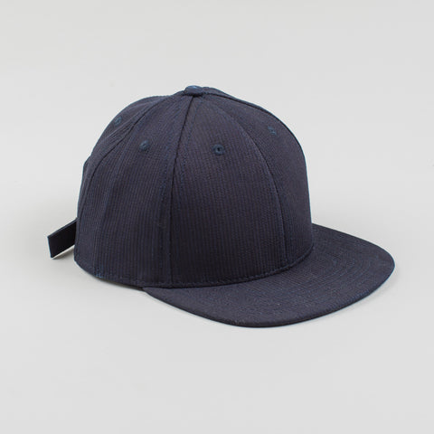 angle: corded indigo | Raleigh Denim Workshop six-panel structured hat in blue corded indigo