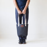 angle hover: denim  Raleigh Denim Workshop denim tote bag with cream handles and leather patch