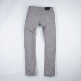 angle: pebble  Raleigh Denim Workshop men's Jones thin fit canvas pants in medium gray pebble, back flat view
