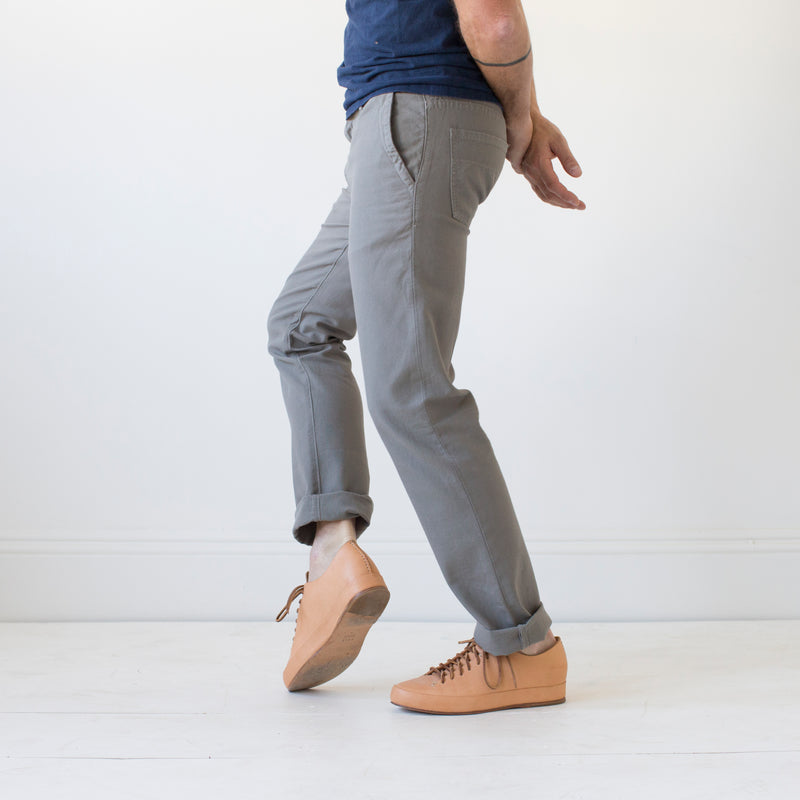 angle: pebble  Raleigh Denim Workshop men's Jones thin fit canvas pants in medium gray pebble.